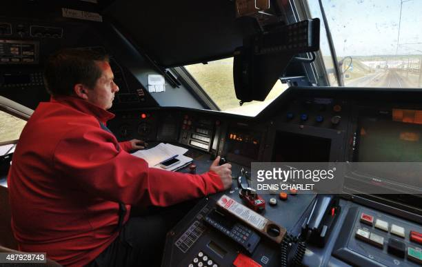 46 years old train driver Willy Crooks drives a EuroTunnel train on April 10 2014 between Calais and Folkestone near Coquelles northern France Crooks...