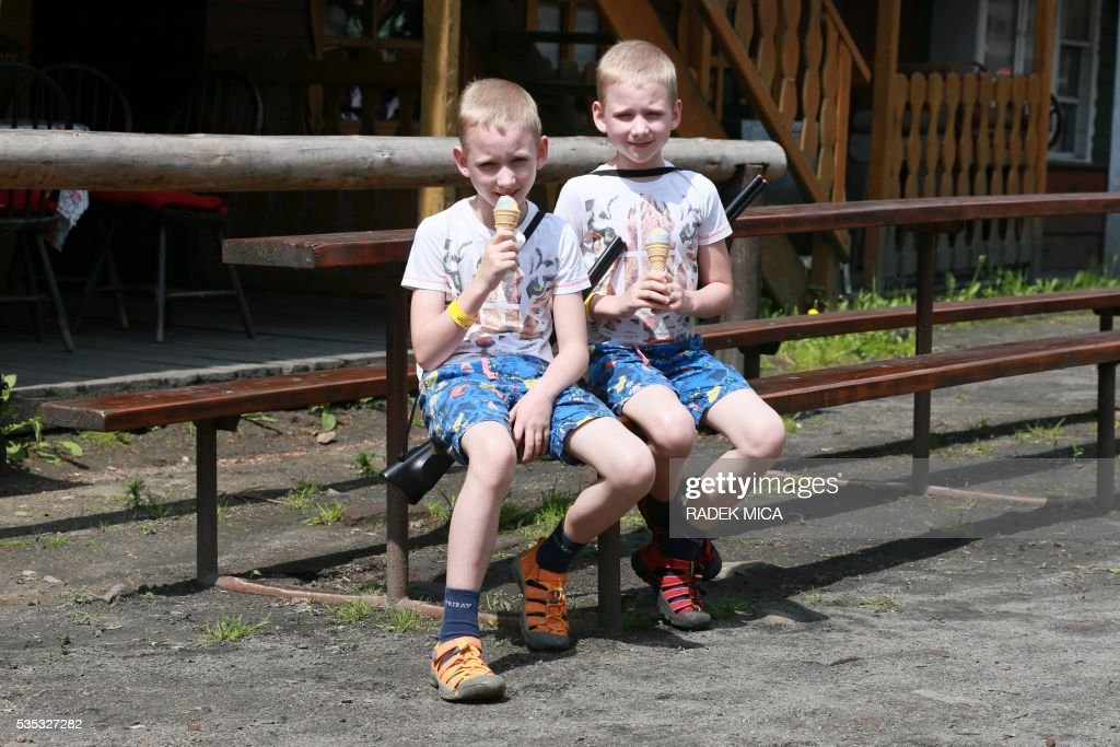 8 years old twins Simon and Matous eat an ice during a meeting of twins and multiples in Zvole, Czech Republic, south Moravia, on May 29, 2016 The biggest meeting of twins and multiples in the Czech Republic was today in Zvole, 40 km east of Brno. Meeting attended by one hundred pairs, take a family photo. This is a unique event in the Czech Republic. / AFP / RADEK