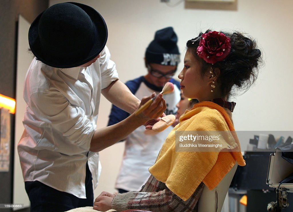 20 years old woman gets make-up for her 'Coming-of-Age Day' celebration at Hair Sakura beauty parlor on January 14, 2013 in Himeji, Japan. The event involves 20-year-old Japanese people celebrating their eligibility to drink alcohol, smoke and vote.