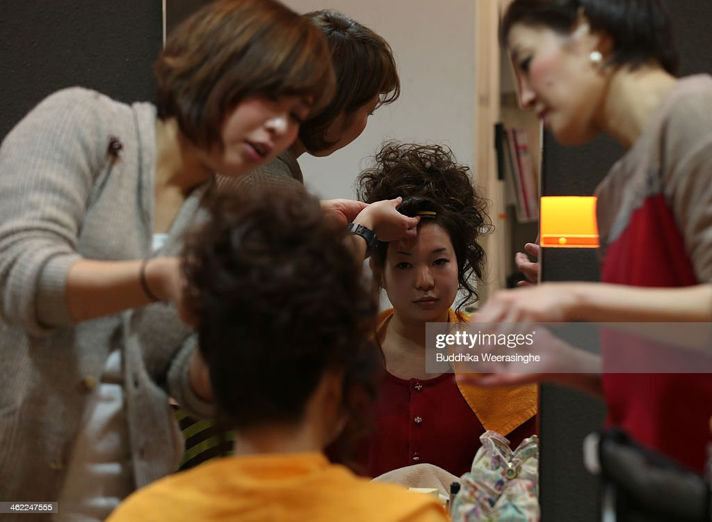 20 years old woman gets make-up for her 'Coming-of-Age Day' celebration at Hair Sakura beauty parlorl on January 13, 2014 in Himeji, Japan. The Coming of Age Day is a Japanese holiday to congratulate and encourage young people who have reached the age 20 as maturity in Japan, when they are legally permitted to smoke, drink alcohol and vote.