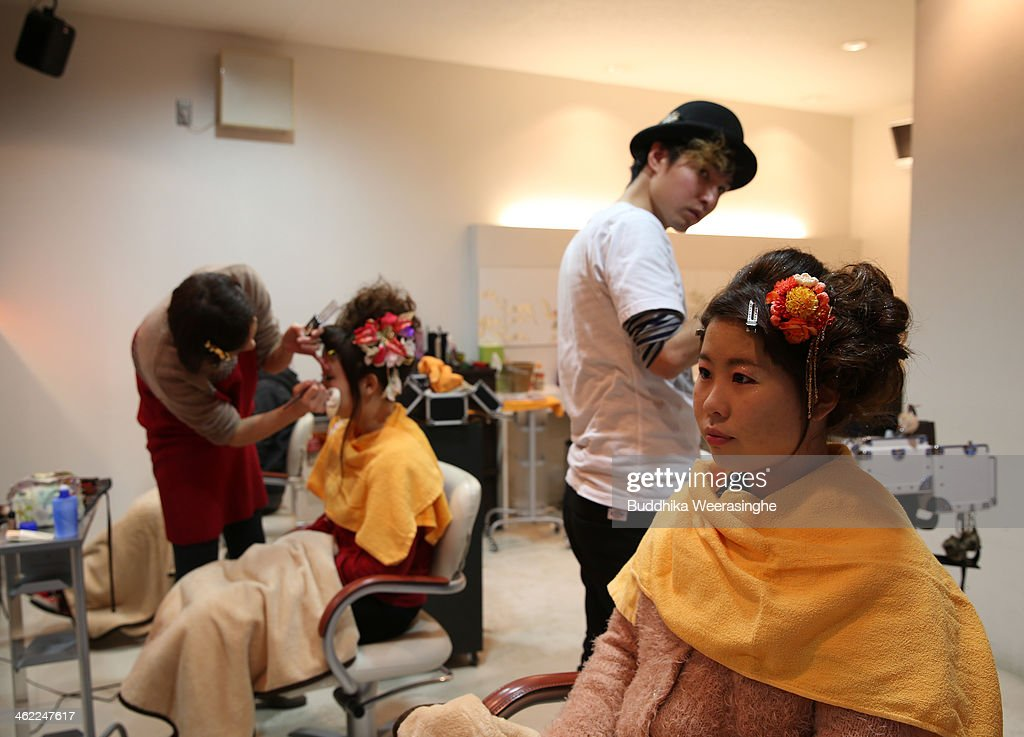 20 years old woman waits make-up for her 'Coming-of-Age Day' celebration at Hair Sakura beauty parlorl on January 13, 2014 in Himeji, Japan. The Coming of Age Day is a Japanese holiday to congratulate and encourage young people who have reached the age 20 as maturity in Japan, when they are legally permitted to smoke, drink alcohol and vote.