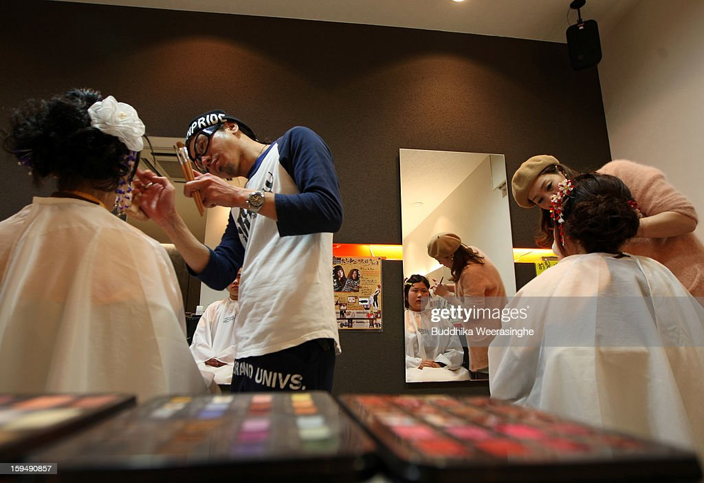 20 years old women get make-up for their 'Coming-of-Age Day' celebration at Hair Sakura beauty parlor on January 14, 2013 in Himeji, Japan. The event involves 20-year-old Japanese people celebrating their eligibility to drink alcohol, smoke and vote.
