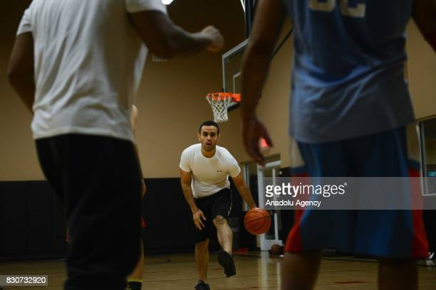 Mohamed Soltan an EgyptianAmerican human rights Advocate who was a political prisoner in Egypt from August 2013 to May 2015 plays basketball in...