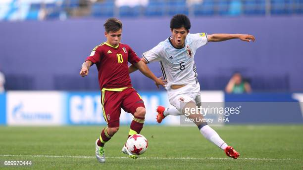 Yeferson Soteldo of Venezuela holds off a challenge from Takehiro Tomiyasu of Japan during the FIFA U20 World Cup Korea Republic 2017 Round of 16...