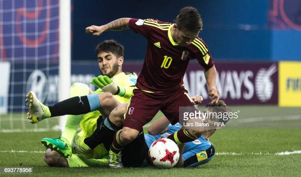 Yeferson Soteldo of Venezuela is challenged by Santiago Mele of Uruguay and Rodrigo Bentancur of Uruguay during the FIFA U20 World Cup Korea Republic...