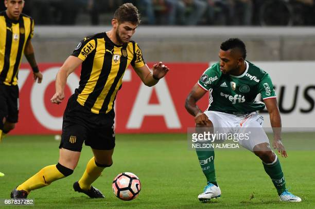 Yefferson Quintana of Uruguay's Penarol vies for the ball with Borja of Brazil's Palmeiras during their 2017 Copa Libertadores football match held at...