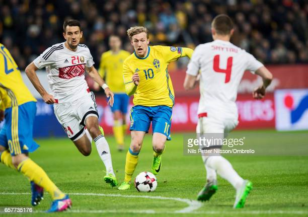 Yegor Filipenko of Belarus and Emil Forsberg of Sweden competes for the ball during the FIFA 2018 World Cup Qualifier between Sweden and Belarus at...