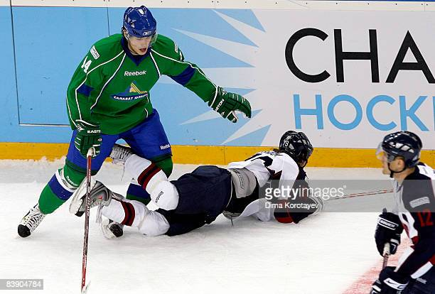 Yegor Kuptsov of Salavat Yulayev Ufa challenges Marek Uram of Slovan Bratislava during the IIHF Champions Hockey League Semi Final match between...