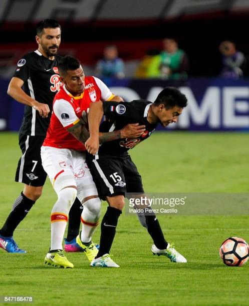 Yeison Gordillo of Santa Fe and Angel Cardozo of Libertad compete for the ball during a second leg match between Independiente Santa Fe and Libertad...