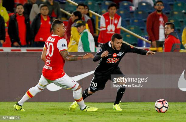 Yeison Gordillo of Santa Fe fight for the ball with Antonio Bareiro of Libertad during a second leg match between Independiente Santa Fe and Libertad...