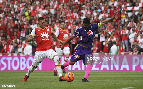 Yeison Gordillo of Santa Fe fights for the ball with Christian Marrugo of Medellin during a second leg final match between Independiente Santa Fe and...