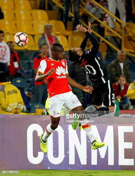 Yeison Gordilloof Santa Fe and Antonio Bareiro of Libertad compete for the ball during a second leg match between Independiente Santa Fe and Libertad...
