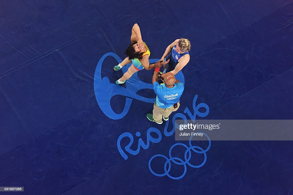 Yekaterina Larionova of Kazakhstan celebrates after defeating Elena Sergey Pirozhkova of the United States during the Women's Freestyle 63 kg Bronze...