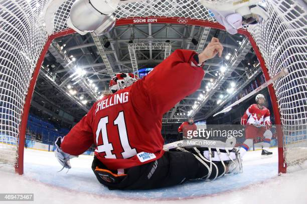 Yekaterina Lebedeva of Russia takes a shot at goal against Florence Schelling of Switzerland during the Women's Ice Hockey Playoffs Quarterfinal game...