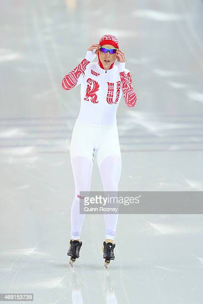 Yekaterina Lobysheva of Russia reacts after competing during the Women's 1000m Speed Skating event on day 6 of the Sochi 2014 Winter Olympics at...