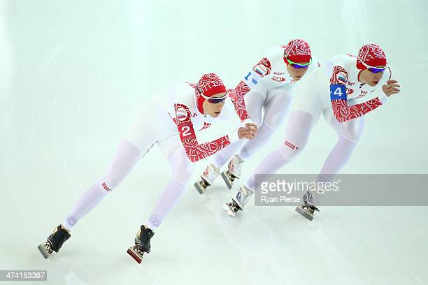 Yekaterina Lobysheva Olga Graf and Yuliya Skokova of Russia compete during the Women's Team Pursuit Final B Speed Skating event on day fifteen of the...