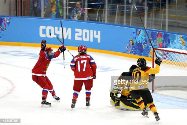 Yekaterina Smolentseva of Russia scores a goal in the third period against Viona Harrer of Germany during the Women's Ice Hockey Preliminary Round...