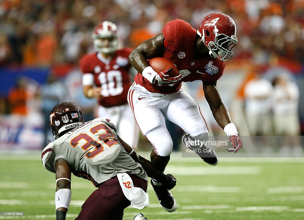 <a gi-track='captionPersonalityLinkClicked' href=/galleries/search?phrase=T.J.+Yeldon&family=editorial&specificpeople=9688955 ng-click='$event.stopPropagation()'>T.J. Yeldon</a> #4 of the Alabama Crimson Tide leaps over Josh Trimble #32 of the Virginia Tech Hokies as he rushes upfield at Georgia Dome on August 31, 2013 in Atlanta, Georgia.