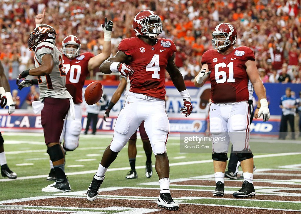 <a gi-track='captionPersonalityLinkClicked' href=/galleries/search?phrase=T.J.+Yeldon&family=editorial&specificpeople=9688955 ng-click='$event.stopPropagation()'>T.J. Yeldon</a> #4 of the Alabama Crimson Tide reacts after scoring a touchdown against the Virginia Tech Hokies at Georgia Dome on August 31, 2013 in Atlanta, Georgia.