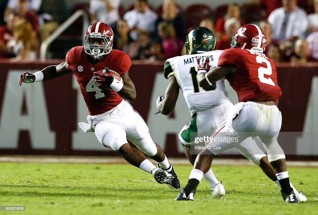 <a gi-track='captionPersonalityLinkClicked' href=/galleries/search?phrase=T.J.+Yeldon&family=editorial&specificpeople=9688955 ng-click='$event.stopPropagation()'>T.J. Yeldon</a> #4 of the Alabama Crimson Tide rushes against the Colorado State Rams at Bryant-Denny Stadium on September 21, 2013 in Tuscaloosa, Alabama.
