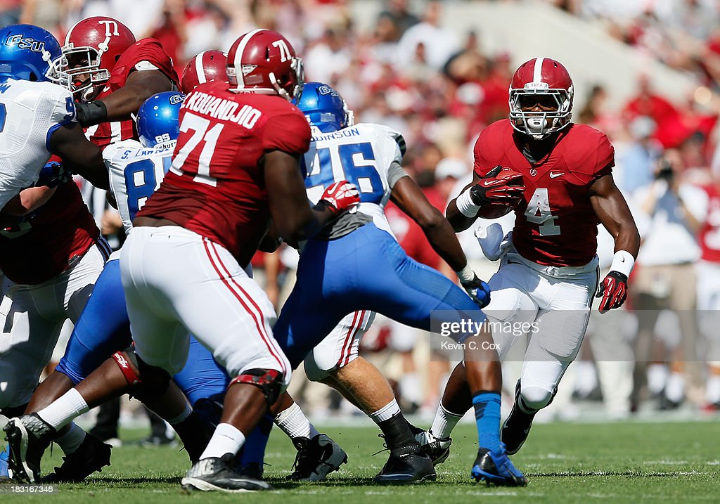 <a gi-track='captionPersonalityLinkClicked' href=/galleries/search?phrase=T.J.+Yeldon&family=editorial&specificpeople=9688955 ng-click='$event.stopPropagation()'>T.J. Yeldon</a> #4 of the Alabama Crimson Tide rushes against the Georgia State Panthers at Bryant-Denny Stadium on October 5, 2013 in Tuscaloosa, Alabama.