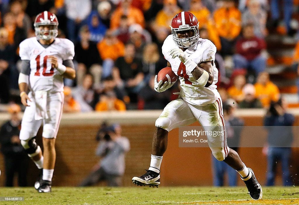 T.J. Yeldon #4 of the Alabama Crimson Tide rushes against the Tennessee Volunteers at Neyland Stadium on October 20, 2012 in Knoxville, Tennessee.
