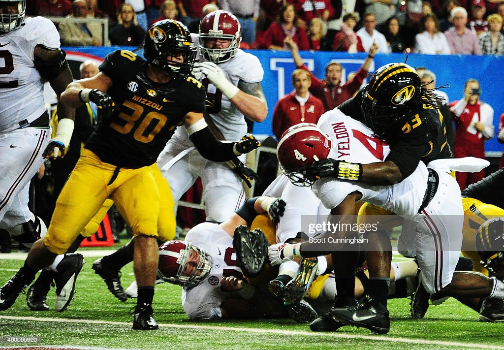 <a gi-track='captionPersonalityLinkClicked' href=/galleries/search?phrase=T.J.+Yeldon&family=editorial&specificpeople=9688955 ng-click='$event.stopPropagation()'>T.J. Yeldon</a> #4 of the Alabama Crimson Tide scores a touchdown against the defense of <a gi-track='captionPersonalityLinkClicked' href=/galleries/search?phrase=Markus+Golden&family=editorial&specificpeople=9839092 ng-click='$event.stopPropagation()'>Markus Golden</a> #33 of the Missouri Tigers in the second quarter of the SEC Championship game at the Georgia Dome on December 6, 2014 in Atlanta, Georgia.
