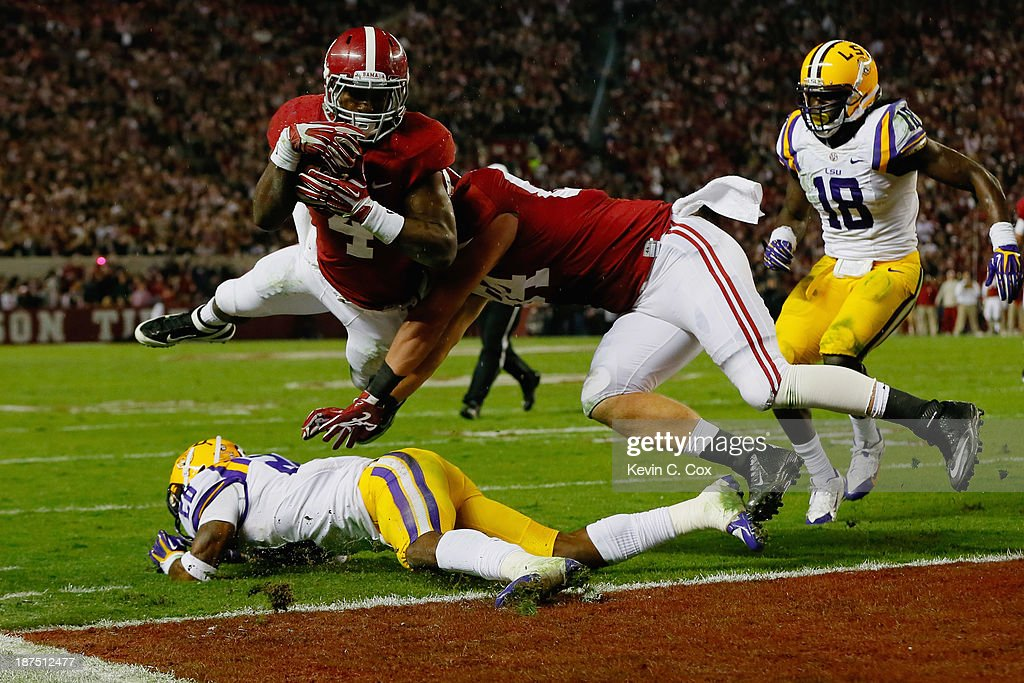 <a gi-track='captionPersonalityLinkClicked' href=/galleries/search?phrase=T.J.+Yeldon&family=editorial&specificpeople=9688955 ng-click='$event.stopPropagation()'>T.J. Yeldon</a> #4 of the Alabama Crimson Tide scores a touchdown in the third quarter against the LSU Tigers at Bryant-Denny Stadium on November 9, 2013 in Tuscaloosa, Alabama.