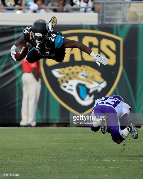 J Yeldon of the Jacksonville Jaguars gets airborne on a tackle by Terence Newman of the Minnesota Vikings during the game at EverBank Field on...