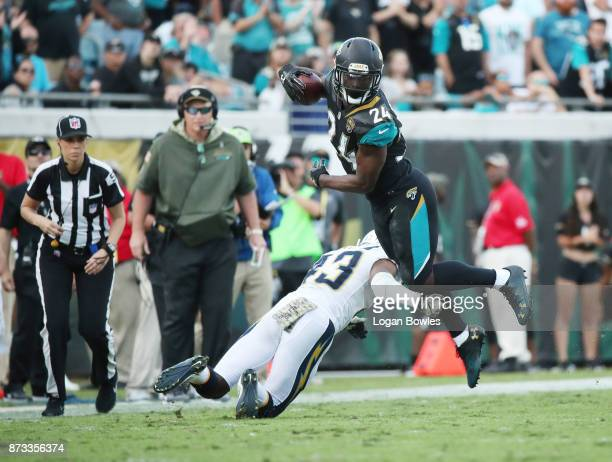 J Yeldon of the Jacksonville Jaguars runs with the football against Michael Davis of the Los Angeles Chargers in the second half of their game at...