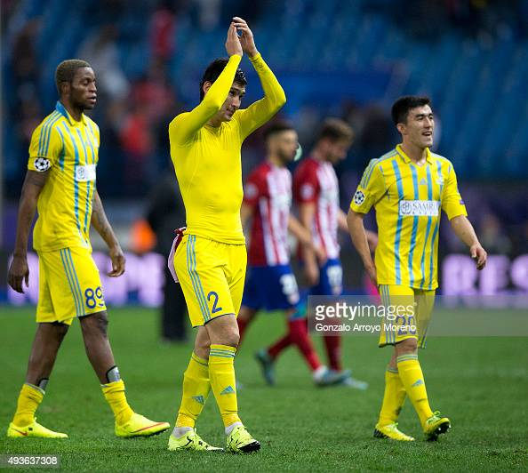 Yeldos Akhmetov of FC Astana claps to his fans surrounded by Junior Kabananga and Zhakyp Kozhamberdy after loosing the UEFA Champions League Group C...