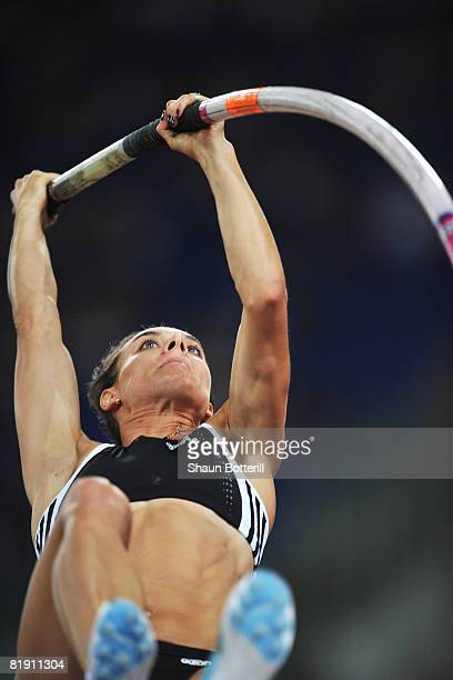 Yelena Isinbaeva of Russia competes on her way to setting a new world record of 503m in the Womens Pole Vault during the IAAF Golden Gala at the...
