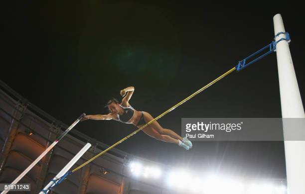 Yelena Isinbaeva of Russia sets a new world record of 503m while competing in the Womens Pole Vault during the IAAF Golden Gala at the Stadio...