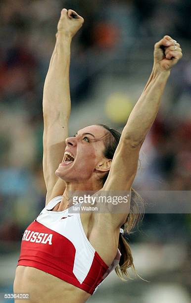 Yelena Isinbayeva of Russia celebrates after she broke the world record during the women's Pole Vault final at the 10th IAAF World Athletics...