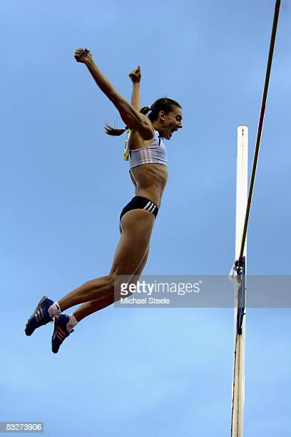 Yelena Isinbayeva of Russia celebrates setting a new Womans Pole Vault World Record of five metres during the Norwich Union Grand Prix meeting on...