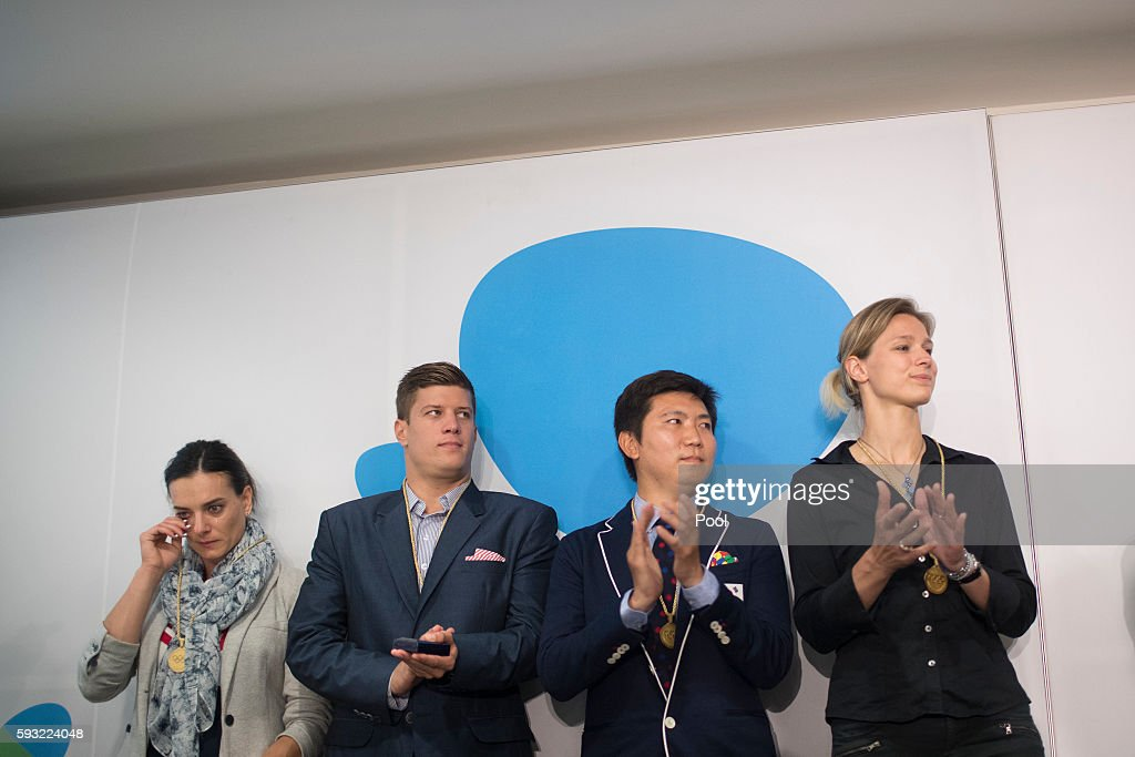 Yelena Isinbayeva of Russia, Daniel Gyurta of Hungary, Ryu Seung-min of South Korea and Britta Heidemann of Germany react after being accepted as members of the International Olympic Committee (IOC) athletes commission at the IOC 129th Session at the 2016 Summer Olympics August 21, 2016. in Rio de Janeiro, Brazil.