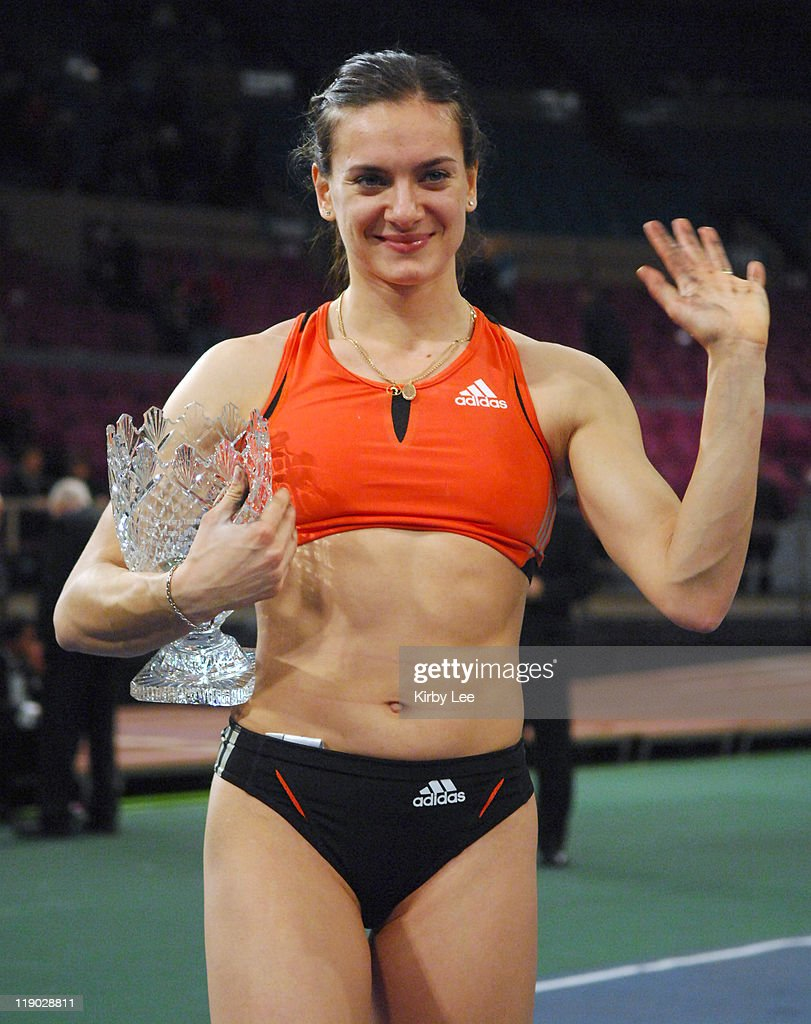 Yelena Isinbayeva of Russia holds Fred Schmertz Waterford Crystal Trophy as the Outstanding Performer of the Meet after winning the women's pole vault in a meet-record 15-9 3/4 (4.82m) in the 100th Millrose Games at Madison Square Garden in New York City, N.Y. on Friday, February 2, 2007.