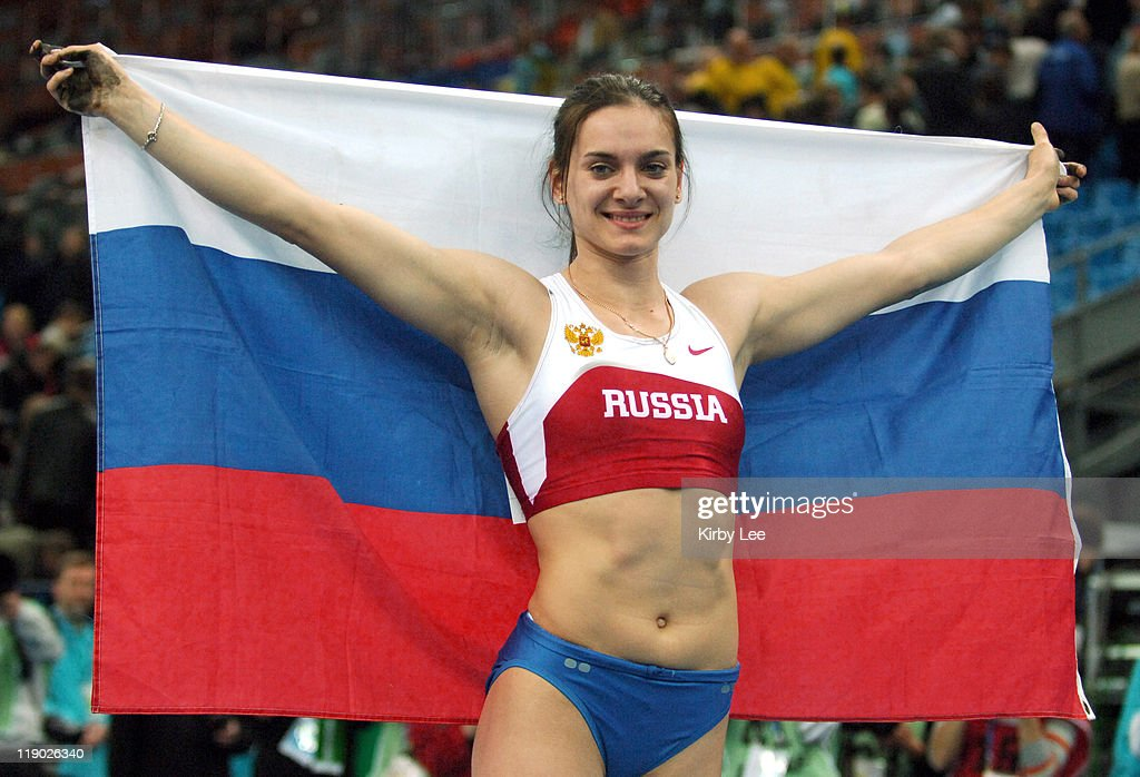 Yelena Isinbayeva poses with Russian flag after winning the women's pole vault at 15-9 (4.80m) in the IAAF World Indoor Championships in Athletics at the Olympiysky Sports Complex in Moscow, Russia on Saturday, March 11, 2006.