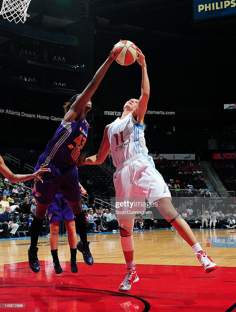 Yelena Leuchanka of the Atlanta Dream battles for a rebound against Nakia Sanford of the Phoenix Mercury at Philips Arena on May 31 2012 in Atlanta...