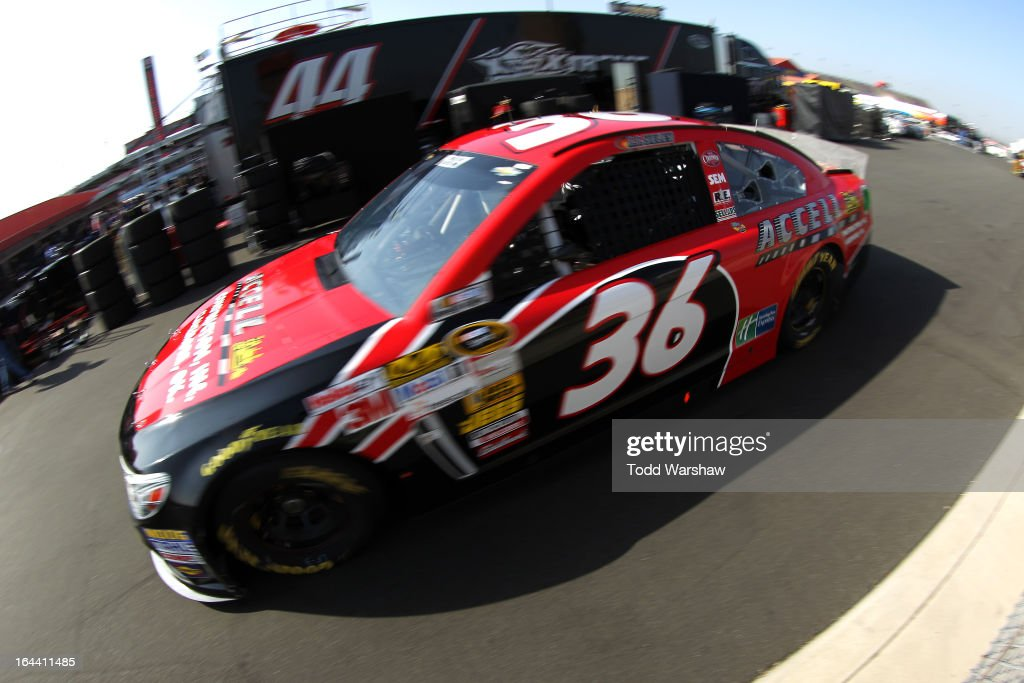 JJ Yeley, driver of the #36 Accell Construction Chevrolet, drives to the garage area during practice for the NASCAR Sprint Cup Series Auto Club 400 at Auto Club Speedway on March 23, 2013 in Fontana, California.