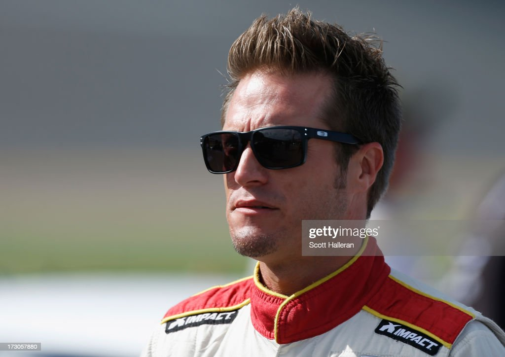 JJ Yeley , driver of the #36 Golden Corral Chevrolet, walks on the grid during qualifying for the NASCAR Sprint Cup Series Coke Zero 400 at Daytona International Speedway on July 5, 2013 in Daytona Beach, Florida.