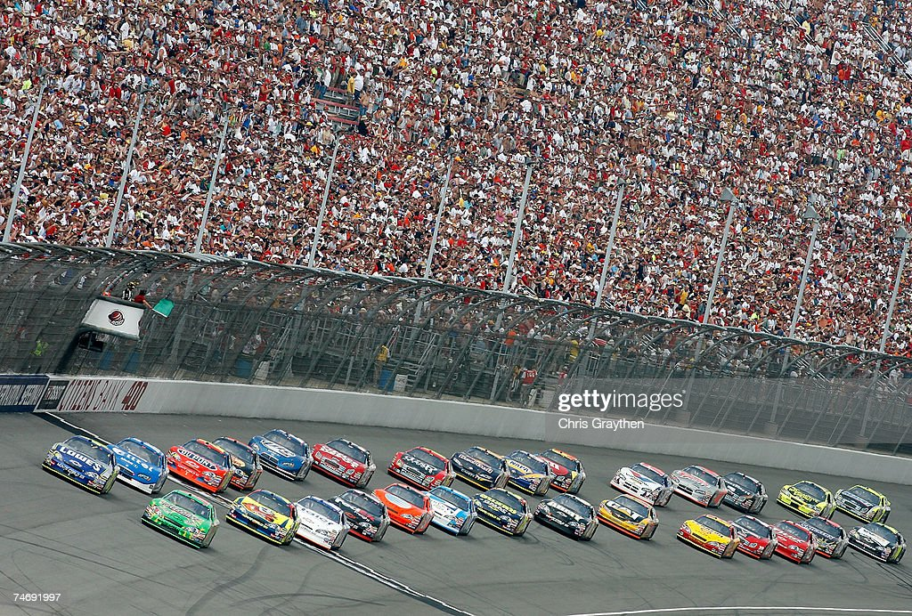 J Yeley driver of the Interstate Batteries Chevrolet and Jimmie Johnson driver of the Lowe's Chevrolet lead the field at the start of the NASCAR...