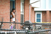 Yelizabeth Acevedo a resident of the Trumbull Gardens housing complex in Bridgeport Conn where nine people were shot early Thursday June 12 looks out...