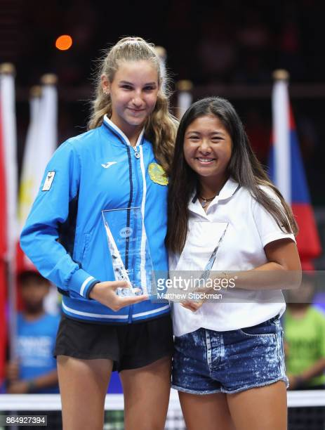 Yelizaveta Karlova of Kazakhstan and Elys Ventura of New Zealand pose with their Li Na Inspiration awards for the Under 14 and Under 16 age...