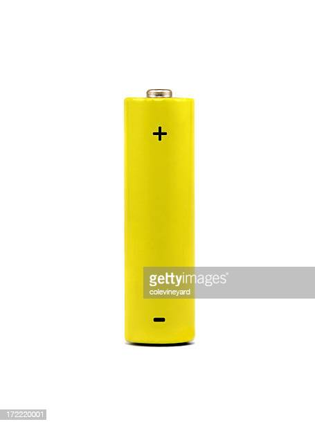 A yellow AA battery on a white background