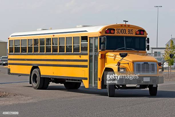 Yellow American Schoolbus pulling out of parking lot