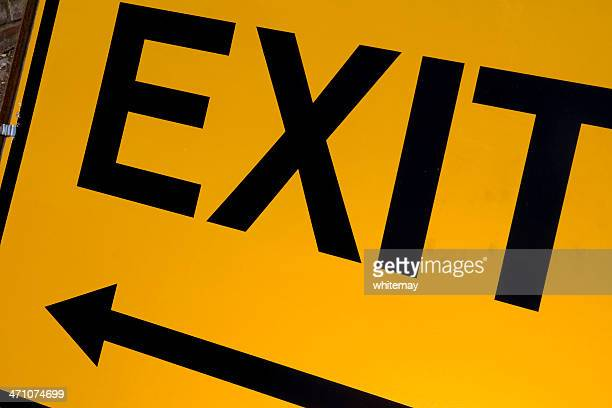 Yellow and black exit sign with arrow