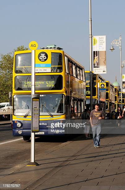 Yellow and Blue painted Dublin buses on Aston Quay in Dublin Ireland