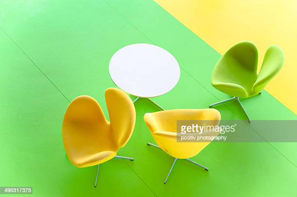 yellow and green chairs on yellow and green floor