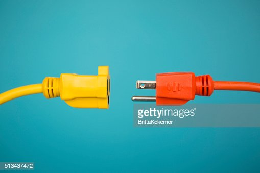 Yellow and Orange electric plug : Stock Photo